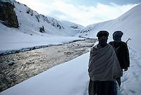 Two Hazara Mujahedin's passing the Wonay Pass at 3352 meters high on the way to Bamiyan. The Kuh e Baba range culminate at 5100 meters high.