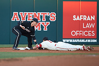 Tyler Fitzgerald (2) of the Louisville Cardinals tags out Evan Mendoza (18) of the North Carolina State Wolfpack at third base at Doak Field at Dail Park on March 24, 2017 in Raleigh, North Carolina. The Wolfpack defeated the Cardinals 3-1. (Brian Westerholt/Four Seam Images)