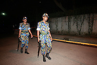 Bangladeshi police stands guard in front of the shooting spot where Italian citizen Tavela Cissera, 50, shoot by unknown assailants at Gulshan-2, Dhaka, Bangladesh.  On September 28, 2015, evening, Italian citizen was shot to dead by unknown assailants in the capital's Gulshan diplomatic zone, Dhaka, Bangladesh.