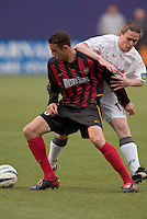 The 8 MetroStars' Mark Lisi and New England Revolution's Richie Baker battle for the ball. The New England Revolution played the NY/NJ MetroStars to a 1 to 1 tie at Giant's Stadium, East Rutherford, NJ, on April 25, 2004.