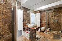 BNPS.co.uk (01202) 558833. <br /> Pic: OrlandoReid/BNPS<br /> <br /> Pictured: Shower room. <br /> <br /> A flat in a ten-storey Art Deco mansion block that was the fictional home of TV detective Hercule Poirot has gone up for rent for £1,950 a month.<br /> <br /> Grade II listed Florin Court in East London was used for filming the long-running ITV series about Agatha Christie's iconic detective.<br /> <br /> The one-bedroom ground floor flat includes a double bedroom, an open plan reception room and kitchen, and a study or home office and<br /> a marble-tiled family bathroom.<br /> <br /> The exterior of the building has strong Art Deco motifs, many of which were used in the filming of Poirot, for 24 years, from 1989 to 2013.