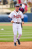 Rome Braves manager Matt Walbeck #11 runs across the field to argue a call at first base during the game against the Hagerstown Suns at State Mutual Stadium on May 1, 2011 in Rome, Georgia.   Photo by Brian Westerholt / Four Seam Images