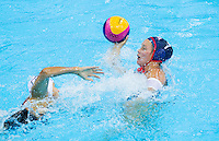 30 JUL 2012 - LONDON, GBR - Courtney Mathewson (USA) of USA looks for a way through the Hungarian defence during the women's London 2012 Olympic Games water polo qualification match in the Olympic Park Water Polo Arena in Stratford, London, Great Britain .(PHOTO (C) 2012 NIGEL FARROW)