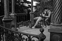 A couple sits in a gazebo in the Jardin des Plantes in Paris, France, five days after coordinated terrorist attacks struck the heart of the French capital. Parks around the city have reopened.
