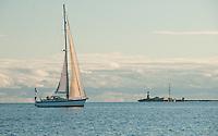 A quiet evening sail near Harmaja lighthouse, off Helsinki, Finland.