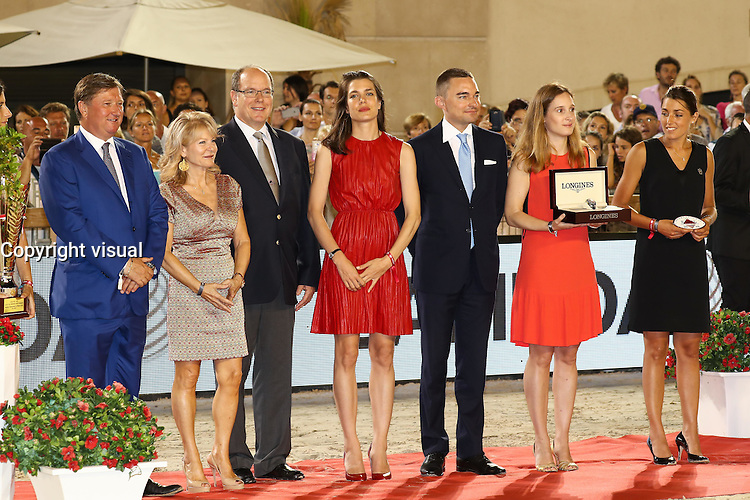--- NO TABLOIDS NO SITE --- H.S.H. Prince Albert II of Monaco and his niece Charlotte Casiraghi give the prizes to Emanuele Gaudiano, winner of the 'Grand Prix du Prince' at the Longines Global Champions Tour of Monaco and to Piergiorgio Bucci (2nd) and Rolf-Gˆran Bengtsson (3rd).