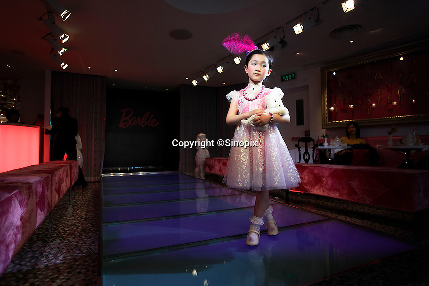 Young girls strut and pose on a small runway at the new Barbie flagship store in Shanghai, China. The six story store was opened in March this year to mark the 50th birthday of Barbie..04 Apr 2009.