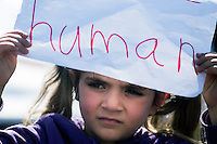"Pictured: A little girl with a ""human"" slogan on a piece of paper Thursday 03 March 2016<br /> Re: Migrants have closed off the railway track at the Greek Fyro Macedonian border in Idomeni, Greece,"