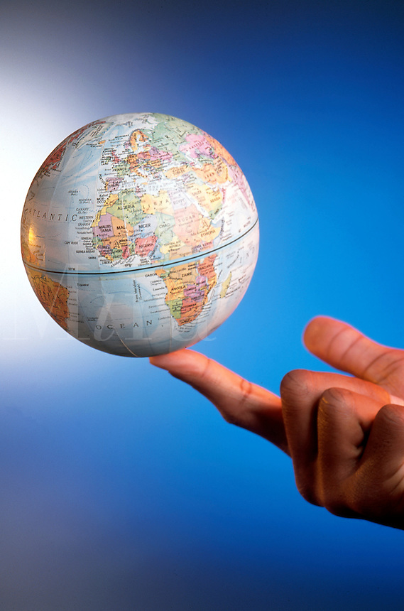 An African American man holds a globe on his finger tip.
