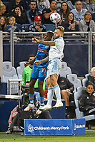 KANSAS CITY, KS - MAY 29: Johnny Russell #7 Sporting KC wins the header against Fafa Picault #10 Houston Dynamo during a game between Houston Dynamo and Sporting Kansas City at Children's Mercy Park on May 29, 2021 in Kansas City, Kansas.