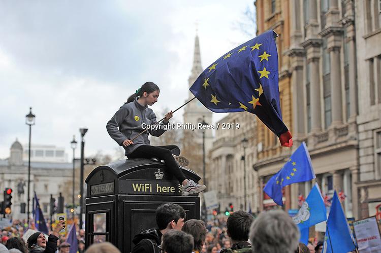 """A protestor waves the flag of Europe from the top of a phone bix during the """"Put it to the People"""" rally which made it's way through central London today. Demonstrators from across the country gathered to call for a second referendum on Brexit and to march through the UK capital finishing with speeches in Parliament Square opposite the Houses of Parliament in Westminster."""