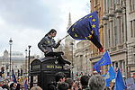 "A protestor waves the flag of Europe from the top of a phone bix during the ""Put it to the People"" rally which made it's way through central London today. Demonstrators from across the country gathered to call for a second referendum on Brexit and to march through the UK capital finishing with speeches in Parliament Square opposite the Houses of Parliament in Westminster."