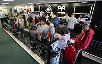 Saturday, 06 June 2015<br /> Pictured: Shoppers queue at the tills<br /> Re: Swansea City FC new home kit launch at the club shop of the Liberty Stadium, south Wales, UK.
