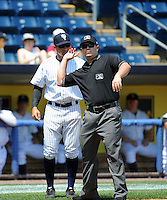 Staten Island Yankees manager Justin Pope (22) is thrown out of game by umpire David Arrieta during game against the Batavia Muckdogs at Richmond County Bank Ballpark at St.George on July 18, 2013 in Staten Island, NY.  Batavia defeated Staten Island 8-2.  (Tomasso DeRosa/Four Seam Images)