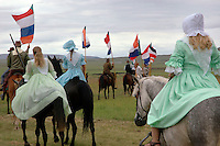 Re-enactment of the Boer horse procession with men holding the old Boer flags at the front. The procession heads for the laager of wagons which forms the monument to the Battle of Blood River. An outnumbered Boer party defeated a Zulu attack and  the Boers made 'a Covenant with God' that if they won the battle  they will always remember this day. The Day of the Vow has since been a significant day in the Afrikaner year. The day is now called the Day of Reconciliation.