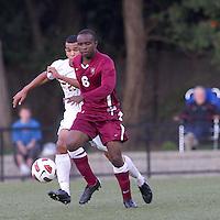 Harvard University defender Baba Omosegbon (6) dribbles as Boston College defender Stefan Carter (23) closes. Boston College defeated Harvard University, 2-0, at Newton Campus Field, October 11, 2011.
