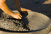 Xingu Indigenous Park, Mato Grosso State, Brazil. Aldeia Waura. Woman making a kamalup clay beju pan.