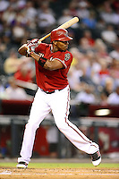 Aug. 29, 2012; Phoenix, AZ, USA: Arizona Diamondbacks outfielder Justin Upton bats in the first inning against the Cincinnati Reds at Chase Field. Mandatory Credit: Mark J. Rebilas-