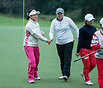 Han Sol Ji of South Korea (left) shakes hands with Felicity Johnson of England during Round 2 of the World Ladies Championship 2016 on 11 March 2016 at Mission Hills Olazabal Golf Course in Dongguan, China. Photo by Victor Fraile / Power Sport Images