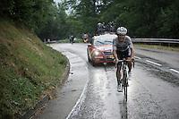 World Champion Michal Kwiatkowski (POL/Etixx-Quickstep) as race leader in the rain up the final climb of the day; the Plateau de Beille<br /> <br /> stage 12: Lannemezan - Plateau de Beille (195km)<br /> 2015 Tour de France