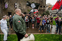 Saturday 05 April 2014<br /> Pictured: A man speaks on a microphone in front of national front supporters Re: White Pride and Anti Fascist groups protest in Swansea City Cebtre