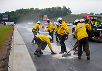 Sep 14, 2019; Mohnton, PA, USA; NHRA safety safari crews clean up oil during qualifying for the Reading Nationals at Maple Grove Raceway. Mandatory Credit: Mark J. Rebilas-USA TODAY Sports