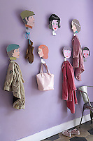 A detail of the entrance hall highlighting a quirky coat rack made of painted faces