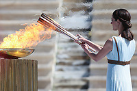 19th March 2020, Athens, Greece; The Olympic Flame, lit on Mount Olympia, is handed over officially to the  congregation from Japan, to be taken to Tokyo for the 2020 Olympic Games in July 2020.