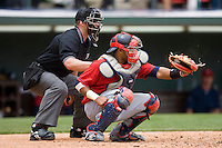 Catcher Carlos Santana #41 of the Columbus Clippers frames a pitch as home plate umpire Stephen Barga looks on during a game against the Charlotte Knights at Knights Stadium May 25, 2010, in Fort Mill, South Carolina.  Photo by Brian Westerholt / Four Seam Images