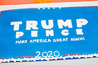 A birthday cake decorated like a 2020 Trump campaign sign for former 2016 Trump campaign manager and current 2020 Trump campaign senior advisor Corey Lewandowski  is seen as people gather for a Trump campaign office opening party in Salem, New Hampshire, on Fri., Sept. 18, 2020. Lewandowski lives in nearby Windham, NH, and attended the party to speak about the ongoing campaign.