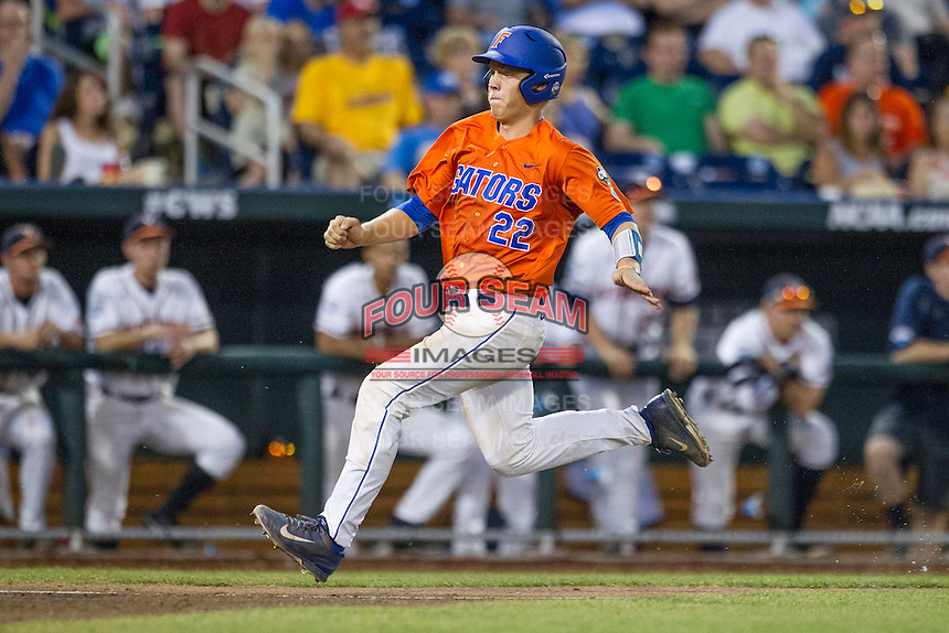Florida Gators catcher JJ Schwarz (22) heads home against the Virginia Cavaliers in Game 13 of the NCAA College World Series on June 20, 2015 at TD Ameritrade Park in Omaha, Nebraska. The Cavaliers beat the Gators 5-4. (Andrew Woolley/Four Seam Images)