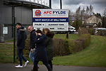 AFC Fylde 1, Aldershot Town 0, 14/03/2020. Mill Farm, National League. Supporters passing a sign advertising the day's fixture before AFC Fylde took on Aldershot Town in a National League game at Mill Farm, Wesham. The fixture was played against the backdrop of the total postponement of all Premier League and EFL football matches due to the the coronavirus outbreak. The home team won the match 1-0 with first-half goal by Danny Philliskirk watched by a crowd of 1668. Photo by Colin McPherson.