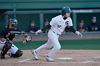 Left fielder Bryce Kelley (17) of the Michigan State Spartans bats in a game against the Maryland Terrapins on Saturday, March 6, 2021, at Fluor Field at the West End in Greenville, South Carolina. (Tom Priddy/Four Seam Images)