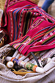 Peru. Bag full of candles and colourful throws.
