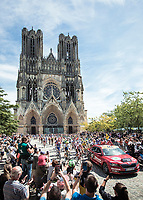 Race start rolling along the impressive Reims Cathedral<br /> <br /> Stage 4: Reims to Nancy (215km)<br /> 106th Tour de France 2019 (2.UWT)<br /> <br /> ©kramon