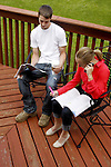 Two teens sitting outside studying
