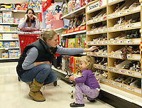 Two-year-old Jessie Miller, right, helps her aunt Jean Rexroad, of Columbus, shop for toys at Target store Tuesday, Nov. 14, 2006 in Columbus, Ohio.<br />