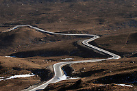 A winding road in the mountains of the Qinghai-Tibetan Plateau. China