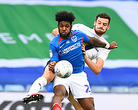 Ellis Harrison of Portsmouth holds off Elliott Moore of Oxford United during Portsmouth vs Oxford United, Sky Bet EFL League 1 Play-Off Semi-Final Football at Fratton Park on 3rd July 2020