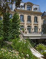 Garden facade of an elegant Beaux-Arts Paris townhouse with original architecture by Henri Deglane