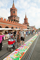 Oberbaumbrucke is a Berlin landmark connecting the districts of Friedrichshain and Kreuzberg across the River Spree, districts that were divided by the Berlin Wall. During the Cold War the bridge was a border post and exchange point for spys. It has now become a symbol of a united Berlin and is the location for a Sunday market..
