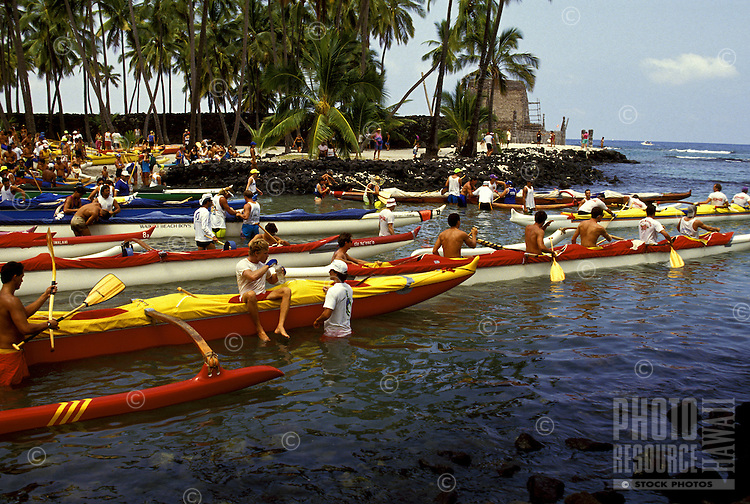 Outrigger canoes at Puu Honua O Honaunau (City of Refuge) in Kona, Hawaii, during the Liliuokalani Canoe Race.