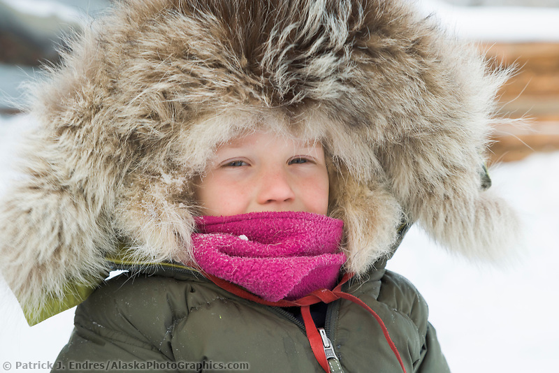 Leo Hicker dressed in a winter parka with a wolf ruff enjoys winter in Wiseman, Alaska, Arctic