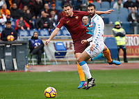 Roma's Edin Dzeko, left, is challenged by Napoli's Raul Albiol during the Italian Serie A football match between Roma and Napoli at Rome's Olympic stadium, 4 March 2017. <br /> UPDATE IMAGES PRESS/Riccardo De Luca