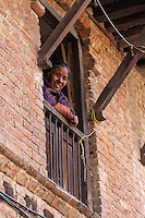 Nepal, Patan.  Woman Looking out of her Window.
