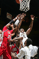 Markhuri Sanders-Frison goes up against Detroit players. The California Golden Bears defeated the Detroit Titans  95-61 during the regional round of the 2K Sports Classic benefiting coaches vs cancer at Haas Pavilion in Berkeley, California on November 11th, 2009.