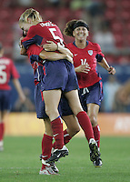 26 August 2004:  Lindsay Tarpley celebrates with Julie Foudy after Lindsay scored a goal in the game againzt Brazil at Karaiskakis Stadium in Athens, Greece.   USA defeated Brazil 2-1 in overtime.   Credit: Michael Pimentel / ISI.