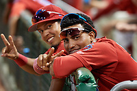 Clearwater Threshers Raul Rivas (foreground) and Jose Antequera (background) gesture to the camera during a game against the Dunedin Blue Jays on April 6, 2018 at Spectrum Field in Clearwater, Florida.  Clearwater defeated Dunedin 8-0.  (Mike Janes/Four Seam Images)