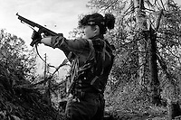 A young female member of the Bosnian Army fires a vintage Thompson sub-machine gun at Bosnian Serb Army positions in Sarajevo's Dobrinja suburb on June 30, 1992.