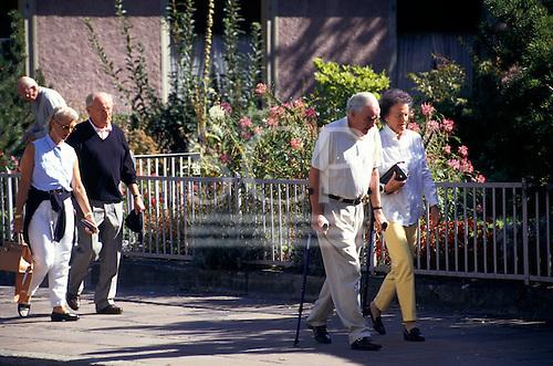 Ragaz, Switzerland. Elderly tourists walking.